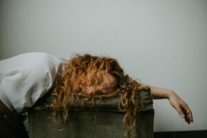 picture of a girl sleeping over a desk snoring